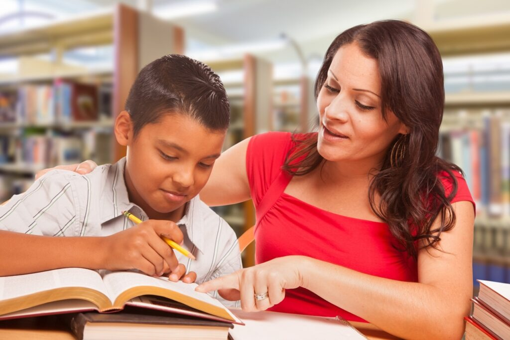 woman math tutoring boy at doral florida library